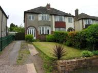 semi detached property in 18 Coton Avenue...