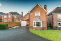Detached property in Meadow Dale Drive...