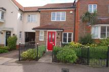 Terraced property in Malkin Drive...
