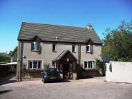 Detached home in Grove House, Main Street...