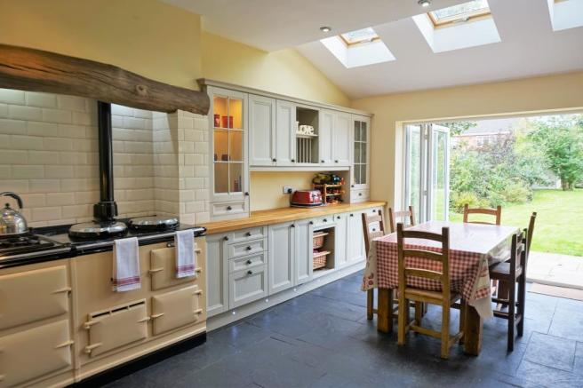 Extended fitted kitchen/dining room showing bi-fold doors