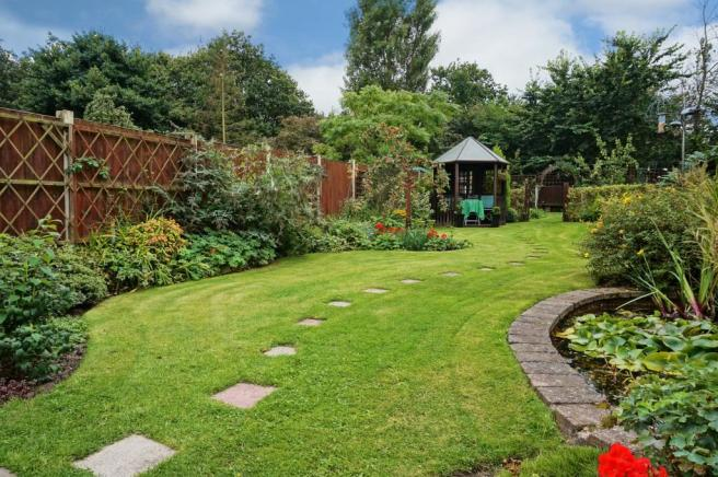 Garden , pond and gazebo.