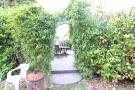 Archway To BBQ Area Garden.JPG