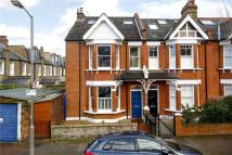 Terraced property in Clonmore Street, London...