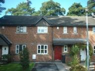 Terraced house in Fox Gardens, Lymm...