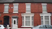 Terraced property in Woodcroft Road...
