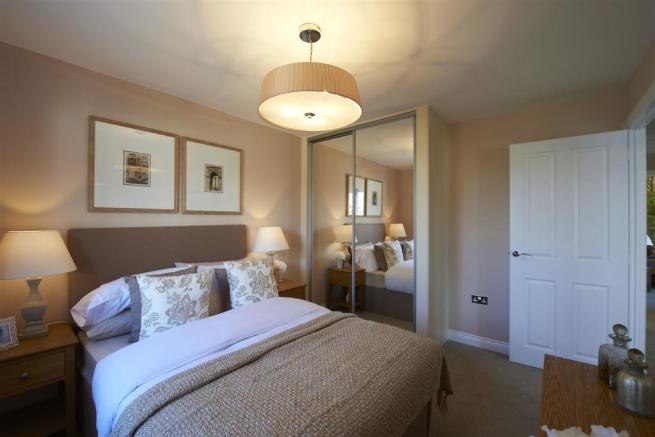 Image depicts a typical Taylor Wimpey bedroom
