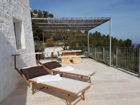 Sun beds and pergola