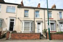 Terraced property in High Street...