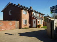 Brown semi detached house for sale