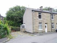 Terraced property in Lee Road, Stacksteads...