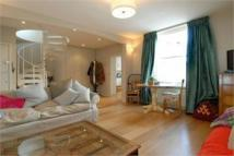 Flat to rent in Netherwood Road, London...