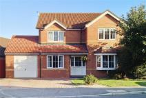Detached home in Cranbourne Close...