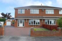 4 bed semi detached property in Redwood Drive...
