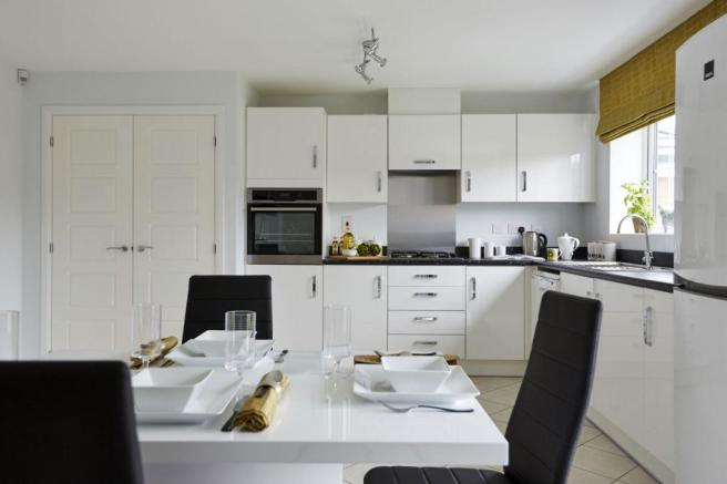 Honeysuckle Grange Chesham show home fitted kitchen with family dining area