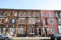Flat to rent in Barton Road, Barons Court