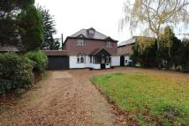 Detached home in Woodmansterne Lane...