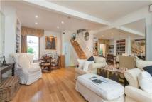 Terraced property for sale in Camborne Road, LONDON...
