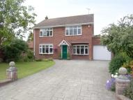 Detached property in 26 Thorpe Road...