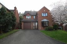 Detached house in Lusbridge Close...