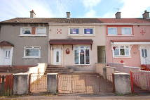 Terraced property in REDWOOD CRESCENT...