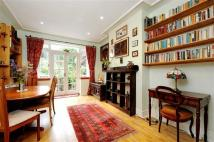 semi detached property in Donnington Road, London...