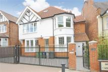 Detached home in Brondesbury Park, London...