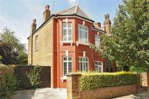 Detached house in Hoveden Road, London...