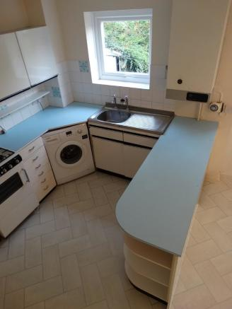 Kitchen from stai...