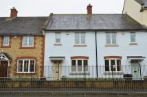 Terraced home for sale in George Maher Court...
