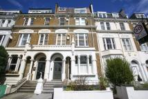 Flat to rent in Sinclair Road, London...