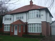 Detached property in Hall Road East...