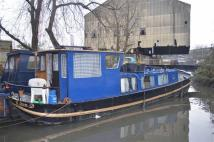 Catherine Wheel Road House Boat
