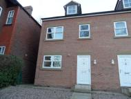 Terraced property in 1 Wellfield Court...