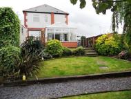 Detached property in 102 Hoyland Road...