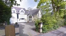 Detached home in 138 Prescot Road...