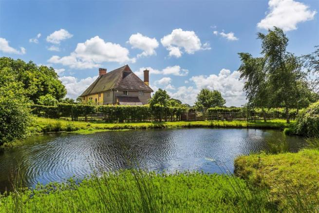 house. estate agency Alfold house and pond