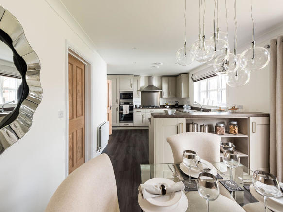 Kitchen and dining area with bi fold doors to the outside