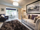 Light and spacious lounge with a feature bay window