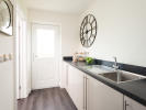Utility room with integrated washing machine