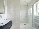 Contemporary en-suite with fitted vanity unity
