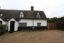 semi detached property in Maltings Farm Cottage...