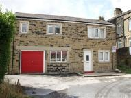 Detached property in Moorlands, Newby Road...