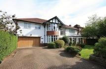 Detached property in Carrwood Road, Wilmslow