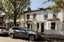 Terraced property in Tasso Road, Barons Court...