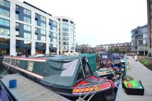 House Boat for sale in Ice Wharf Marina...