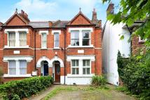 Flat to rent in Fairlawn Road, Wimbledon...