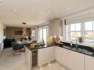 Kitchen / breakfast / family area with bi-fold doors to the patio