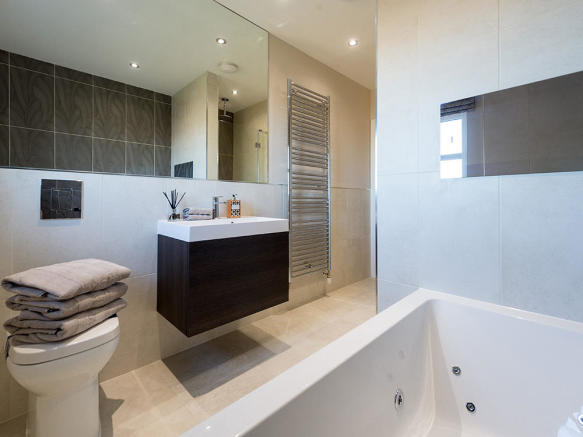 Family bathroom with extensive tiling