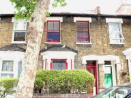 Terraced house in HUDDLESTONE ROAD, London...